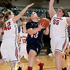 Brad Davis/The Register-Herald<br /> Independence's Jessica Lilly drives to the basket through Liberty defenders Madison Stone, left, and Stacy Williams, right, Saturday afternoon at the Beckley-Raleigh County Convention Center.