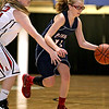 Brad Davis/The Register-Herald<br /> Independence's McKinley Blankenship tries to work her way around Liberty's Madison Stone, left, Saturday afternoon at the Beckley-Raleigh County Convention Center.