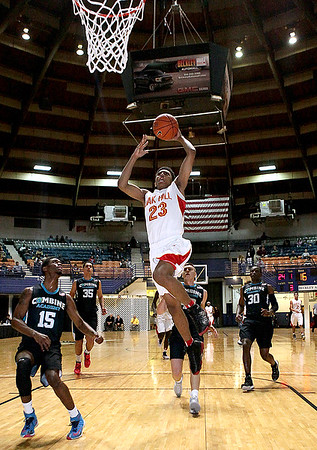 Brad Davis/The Register-Herald<br /> Oak Hill Academy's Joshua Reaves soars to the basket Wednesday night at the Beckley-Raleigh County Convention Center.