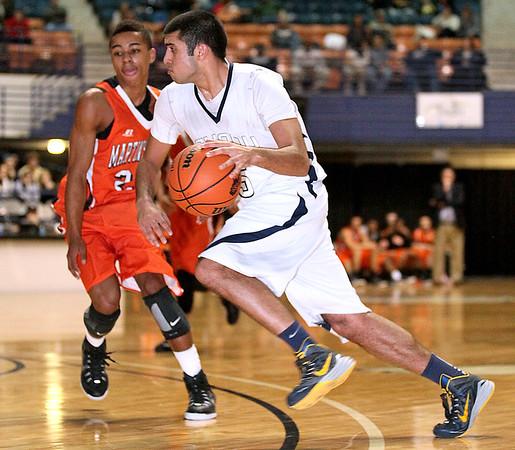 Brad Davis/The Register-Herald<br /> Shady Spring's Steven Chhabra drives to the basket against Martinsburg Friday night.