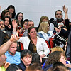 Brad Davis/The Register-Herald<br /> Concerned citizens wait with their hands raised to speak and ask questions of school administrators on the Collins Middle School situation during a packed community meeting Wednesday night in the Oak Hill High School auditorium.