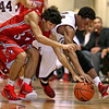 Brad Davis/The Register-Herald<br /> Woodrow Wilson's Malyk Fowlkes and Washington's Jonathan McFarlin rush for a loose ball during Big Atlantic Classic action Friday night at the Beckley-Raleigh County Convention Center.