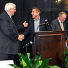 Brad Davis/The Register-Herald<br /> New Orleans Saints head coach Sean Payton, middle, is greeted by tournament chairman Jim Justice as he's introduced as the keynote speaker of the Big Atlantic Classic Banquet Sunday afternoon at the Beckley-Raleigh County Convention Center