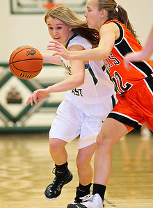 Brad Davis/The Register-Herald Wyoming East's Gabby Lupardus drives to the basket as Summers County's Whittney Justice tries to stop her during the Warriors' win over the Lady Bobcats Thursday night in New Richmond.