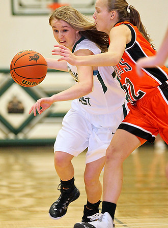 Brad Davis/The Register-Herald<br /> Wyoming East's Gabby Lupardus drives to the basket as Summers County's Whittney Justice tries to stop her during the Warriors' win over the Lady Bobcats Thursday night in New Richmond.
