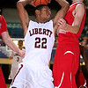 Brad Davis/The Register-Herald <br /> Liberty's Tre McDowell tries to maintain possession as he's pressured under the basket by Independence's Aaron Hunt Saturday afternoon at the Beckley-Raleigh County Convention Center.