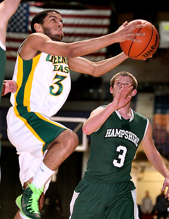 Brad Davis/The Register-Herald<br /> Hampshire's Austin Clem can only watch as Greenbrier East's Christian Ortiz soars to the basket for two points during Big Atlantic Classic action Friday night at the Beckley-Raleigh County Convention Center.