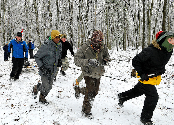 Brad Davis/The Register-Herald<br /> Scouts from Troop 75 in Sophia hustle through ice and snow to their next station with a sled carrying various tools and supplies during the Boy Scouts of America's Klondike Derby event Saturday morning at Churchlands Camp off Pluto Road near Shady Spring.