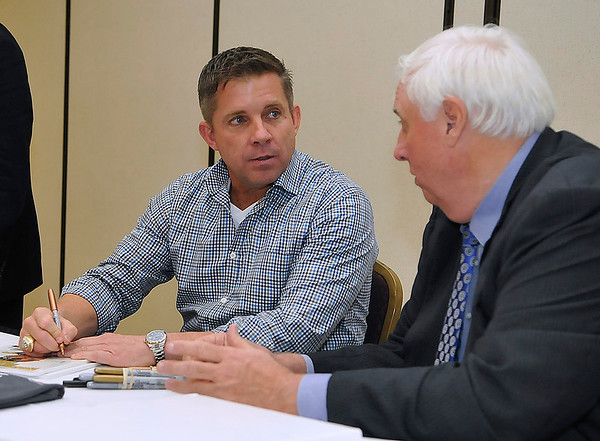 Brad Davis/The Register-Herald<br /> New Orleans Saints head coach Sean Payton talks with tournament chairman Jim Justice prior to an autograph session after the Big Atlantic Classic Banquet concluded Sunday afternoon at the Beckley-Raleigh County Convention Center.