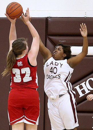 Brad Davis/The Register-Herald<br /> Woodrow Wilson's Bre'ana Staunton makes a defensive stop on Cabell Midland's McKenna Adkins during the Lady Eagles' win over the Knights Friday night.