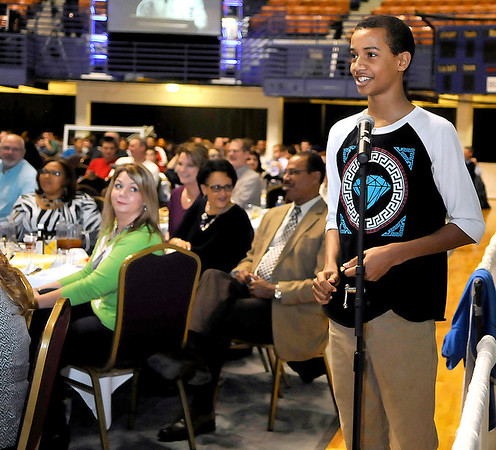 "Brad Davis/The Register-Herald<br /> Beckley-Stratton football and basketball player Michael Beasley ask Saints head coach Sean Payton a question during the Big Atlantic Classic Banquet Sunday afternoon at the Beckley-Raleigh County Convention Center. Beasley, possibly preparing for a career in journalism, asked Payton the toughest question of the day, inquiring whether or not he put bounties on other players around the league during the infamous ""bounty-gate"" ordeal that got him suspended for an entire season. Payton was a good sport about it, responding with a smile, ""that's a great question,"" before answering thoughtfully and finishing with ""but no, I did not."""
