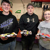 "Brad Davis/The Register-Herald<br /> Young slot car racers (from left) R.J. Smith, Gray Bowyer and Henry Hornsby III show off their cars Saturday night. While all three regularly achieve racing glory at Dirt Slotz, Hornsby, 15, is an actual race car driver who pilots a ""crate late model"" dirt car that looks exactly like the slot car he's holding. His Dirt Slotz car is a replica of the one he drives for real at places like the Beckley Motor Speedway and other tracks he's raced at along the East coast over his two-year career."
