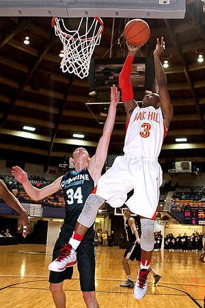 Brad Davis/The Register-Herald<br /> Oak Hill Academy's Terrence Phillips scores as Combine Academy's Jure Span defends during Big Atlantic Classic action Wednesday night at the Beckley-Raleigh County Convention Center.