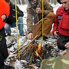 Brad Davis/The Register-Herald<br /> Scouts work at the fire starting station during the Boy Scouts of America's Klondike Derby event January 24 at Churchlands Camp off Pluto Road near Shady Spring.