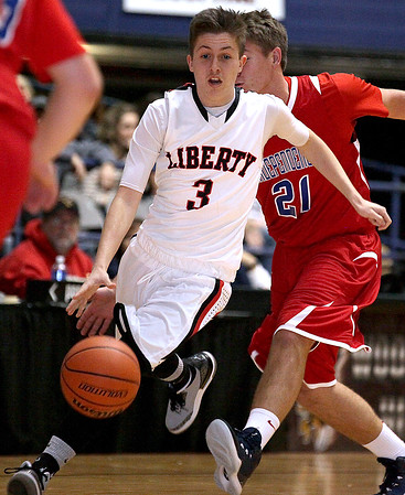Brad Davis/The Register-Herald<br /> Liberty's Devin Acord hustles the ball up the court against Independence Saturday evening at the Beckley-Raleigh County Convention Center.