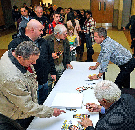 Brad Davis/The Register-Herald<br /> New Orleans Saints head coach Sean Payton, upper right, chats with fans as he and tournament chairman Jim Justice, lower right, hang out and sign autographs following the Big Atlantic Classic Banquet Sunday afternoon at the Beckley-Raleigh County Convention Center.