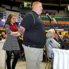 Brad Davis/The Register-Herald<br /> St. Albans resident Katelyn Fields and Beckley resident J.D. Austin wait patiently at the microphone for a chance to ask Saints head coach Sean Payton a question during the Big Atlantic Classic Banquet Sunday afternoon at the Beckley-Raleigh County Convention Center.