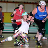 "Brad Davis/The Register-Herald<br /> Heart of Appalachia Roller Derby member Brandy ""Bandita La Bruise"" Kessler, middle, takes a minor tumble as she battles for position with Beckley Area Derby Dame Shannon ""Hollywood Hiplash"" Hoffman, right, and B.A.D.D.'s Kristin ""April O'Kill"" Goodness (background) during a combined West Virginia All-Stars and Dames practice Sunday afternoon at the MacArthur Skating Rink. The Derby Dames have been hosting the West Virginia All-Stars practices every Sunday here in Beckley, and many of their members are on the team along with skaters from other teams in the state such as the Greenbrier Roller Vixens, Morgantown Roller Vixens, Heart of Appalachia Roller Derby and the Chemical Valley Roller Girls. They're preparing for the Battle of the All-Stars States Tournament in Hatfield, Pennsylvania just North of Philadelphia where they'll be one of 10 teams competing for nationwide bragging rights. The tournament runs from February 6th through the 8th and the team will practice at MacArthur Skating Rink every Sunday until then."