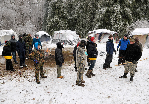 Brad Davis/The Register-Herald<br /> Scouts from Troop 75 in Sophia gather outside of their frozen encampment prior to the start of the Boy Scouts of America's Klondike Derby event Saturday morning at Churchlands Camp off Pluto Road near Shady Spring. Their winter survival skills were put to the test by a cold rain that froze everything before turning to snow overnight.
