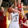 Brad Davis/The Register-Herald<br /> Wyoming East's Kara Sandy drives to the basket as St. Albans defenders Cameron Davis, right, Lexie Cooper, middle, and Allie Johnson, left, converge on her during Big Atlantic Classic action Wednesday night at the Beckley-Raleigh County Convention Center.