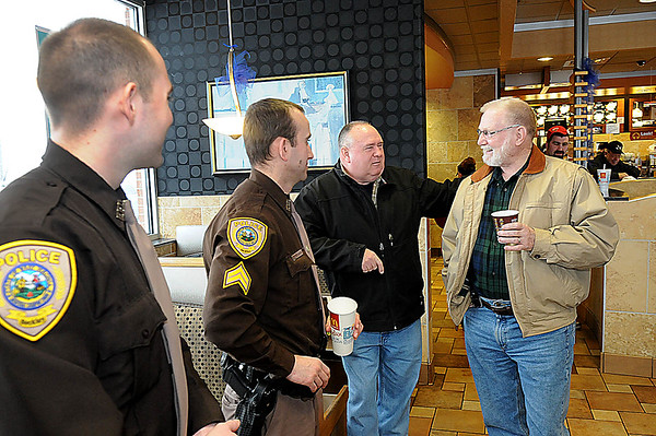 Rick Barbero/The Register-Herald<br /> Beckley City Police officers from left, A. Gibson, and A.W. Jones, have a cup of coffee, with, Athur Gibson and Paul Roop, of Bradley, at McDonald's on Robert C Byrd Drive near the Beckley Plaza Mall. Beckely City Police and McDonalds joined together Friday morning from 8:30 am to 10:30 am for a program called, Coffe with a Cop.