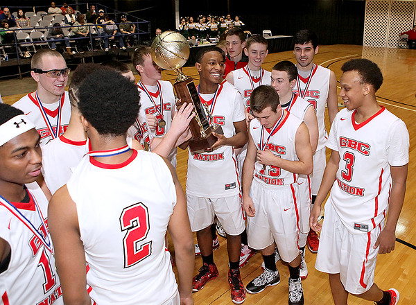 Brad Davis/The Register-Herald<br /> The Crusaders gather around the championship trophy after Greater Beckley Christian defeated Gilmer County in the class A final Thursday night at the Beckley-Raleigh County Convention Center.