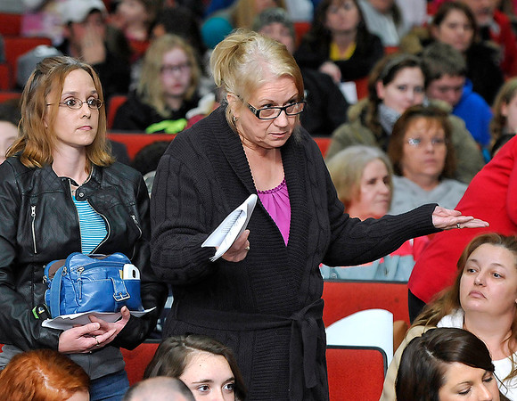 Brad Davis/The Register-Herald<br /> Concerned citizen Deanna Taylor, right, expresses her feelings on the Collins Middle School situation during a packed community meeting Wednesday night in the Oak Hill High School auditorium.