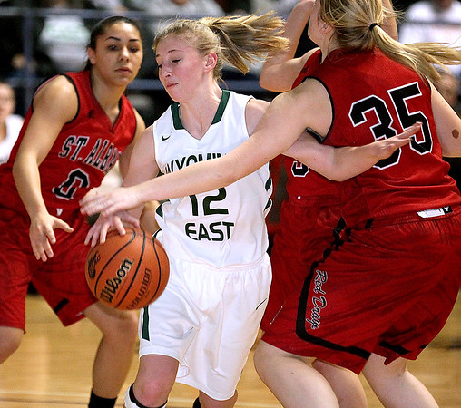 Brad Davis/The Register-Herald<br /> Wyoming East's Misa Quesenberry tries to cut St. Albans defenders Jaden McDaniels, left, and Allie Johnson, right, during Big Atlantic Classic action Wednesday night at the Beckley-Raleigh County Convention Center.