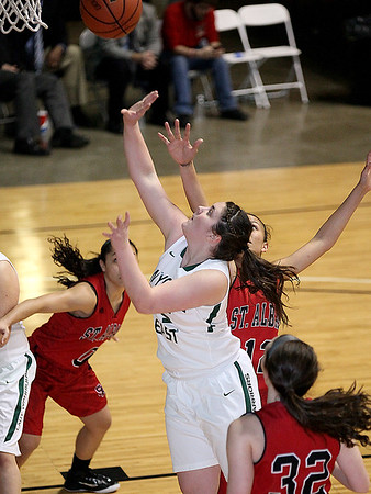 Brad Davis/The Register-Herald<br /> Wyoming East's Brianne Pertee drives to the basket against St. Albans Friday night.