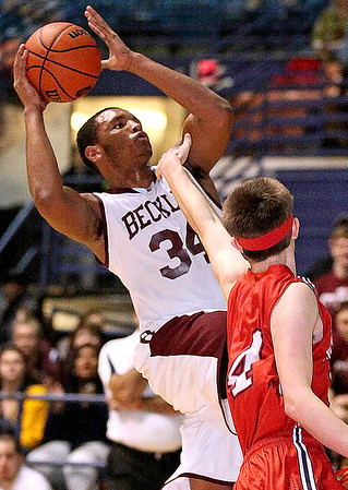 Brad Davis/The Register-Herald<br /> Woodrow Wilson's Noah Hancock drives to the basket during Big Atlantic Classic action Friday night at the Beckley-Raleigh County Convention Center.