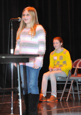 Rick Barbero/The Register-Herald<br /> Kelly Mills, Reach, left, spells semantics correctly to win the Raleigh County Elementary School Spelling Bee Tuesday morning at Woodrow Wilson H.S. auditorium. Sitting in background is the runner-up, Dacia Honaker, Beckley Elementary.
