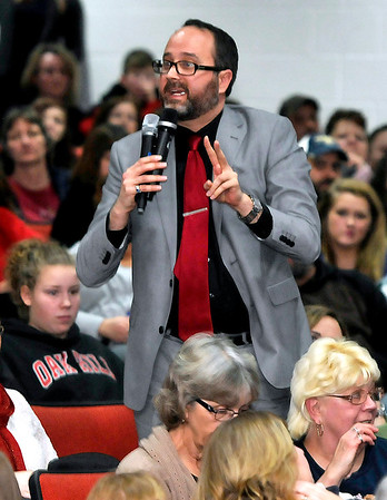 Brad Davis/The Register-Herald<br /> Jason Crouch, Co-President of the Fayette County Education Association, speaks during a community meeting on the Collins Middle School situation Wednesday night in the Oak Hill High School auditorium.