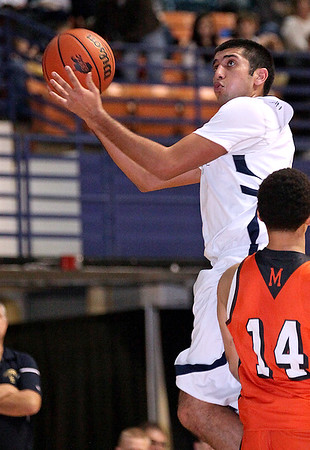 Brad Davis/The Register-Herald<br /> Shady Spring's Steven Chhabra drives to the basket against Martinsburg Friday night.