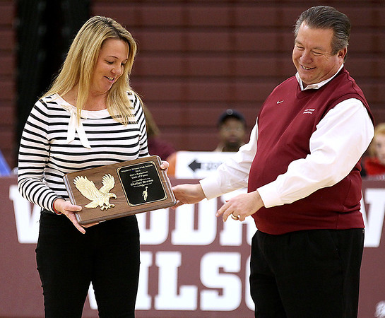 Brad Davis/The Register-Herald<br /> Former Woodrow Wilson Lady Eagles player Shelley Brown, now Culicerto, accepts her plaque from Richard Jarrell during her halftime Hall of Fame induction ceremony Friday night.