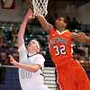 Brad Davis/The Register-Herald<br /> Shady Spring's Jonathan Sawyer tries to score as Martinsburg's Jarrell Jones catches him at the rim during Big Atlantic Classic action Friday evening at the Beckley-Raleigh County Convention Center.