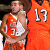 Brad Davis/The Register-Herald<br /> Shady Spring's Nathan Williams looks for a way around Martinsburg's Dylan Smith during Big Atlantic Classic action Friday evening at the Beckley-Raleigh County Convention Center.