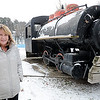 Rick Barbero/The Register-Herald<br /> Leslie Baker, director of Exhibition Coal Mine, stands in front of the dinky train at New River Park.