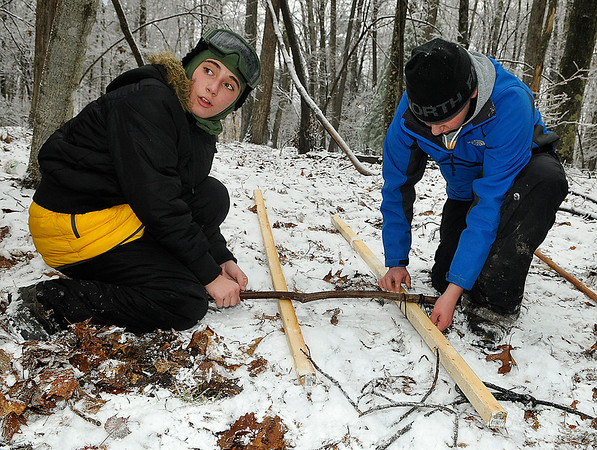 Brad Davis/The Register-Herald<br /> Scouts work at the knots and lashing station during the Boy Scouts of America's Klondike Derby event January 24 at Churchlands Camp off Pluto Road near Shady Spring.