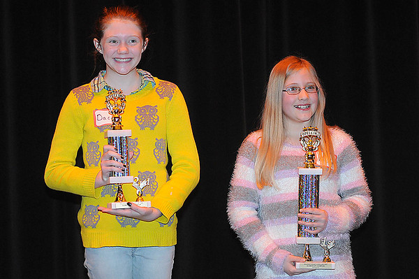Rick Barbero/The Register-Herald<br /> Dacia Honaker, Beckley Elementary, runner-up, left, and Kelly Mills, Reach, winner, hold trophies up after the Raleigh County Elementary School Spelling Bee Tuesday morning at Woodrow Wilson H.S. auditorium.