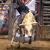 Brad Davis/The Register-Herald<br /> Lexington, Virginia's Dixon Holland hangs on as he competes in the Southern Extreme Bull Riding Association's event Saturday night at Beckley-Raleigh County Convention Center.