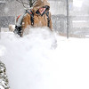 Rick Barbero/The Register-Herald <br /> Derek Kincaid with Bays services, blows snow off the sidewalk for Chase Bank on Neville Street in Beckley Wednesday morning.