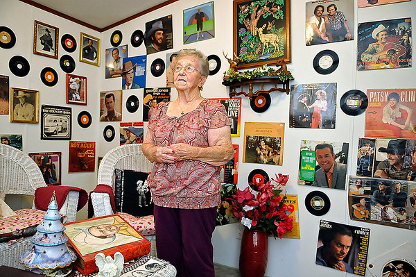 Brad Davis/The Register-Herald<br /> Fairdale resident Edna Allen, sister of Bolt legend Little Jimmy Dickens, speaks with the Register-Herald during a visit to her Brunty Hollow home December 30. She may have one of the most extensive and treasured classic country music collections in the state and has an entire room devoted to her brother and other musicians from the genre's golden age. If you were a collector, you'd have a hard time trying to find some of the Dickens vinyl albums, books, newspaper, magazine articles and even clothing she posesses in her defacto hall of fame. Almost every Dickens album and piece of memorabilia she has was given to her by him directly.
