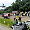 Brad Davis/The Register-Herald<br /> A helicopter lifts off from the Southbound lane of I-64/I-77 just before the split carrying one of five people injured in an afternoon accident Friday afternoon.