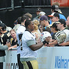 Rick Barbero/The Register-Herald<br /> Saints players signing autographs after the New Orleans Saints first day of practice held at The Greenbrier Resort in White Sulphur Springs Thursday morning.