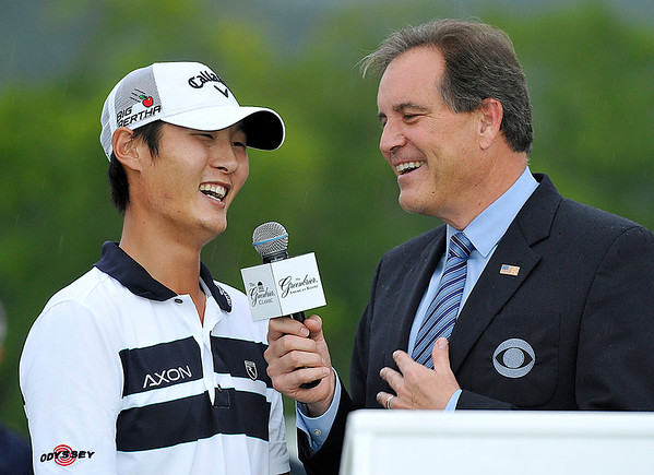 Brad Davis/The Register-Herald<br /> Danny Lee shares a laugh with CBS Sports' Jim Nantz following his Greenbrier Classic win Sunday in White Sulphur Springs.