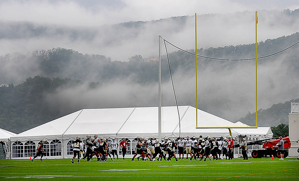 Rick Barbero/The Register-Herald<br /> Fog setting in the background during the New Orleans Saints first day of practice held at The Greenbrier Resort in White Sulphur Springs Thursday morning.
