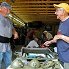 Brad Davis/The Register-Herald<br /> Korean War veteran Boyd Hiser, right, chats with WVMV Veterans Support member Kevin Greene of Flat Top as he works on some of the parts for his Jeep Saturday.