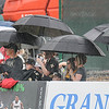 Rick Barbero/The Register-Herald<br /> Spectators trying to stay dry during the New Orleans Saints first day of practice held at The Greenbrier Resort in White Sulphur Springs Thursday morning.