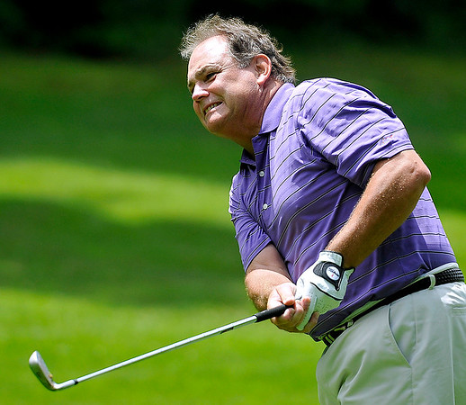Brad Davis/The Register-Herald<br /> Robert Wharton leans over to watch his fairway shot on two during BNI Memorial Tournament action Saturday at Brier Patch Golf Course.