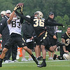 Rick Barbero/The Register-Herald<br /> Willie Snead, left, pulls down a catch against P.J. Williams during the New Orleans Saints first day of practice held at The Greenbrier Resort in White Sulphur Springs Thursday morning.